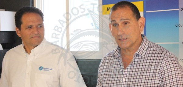 CEO of Caribbean LED Gerard Borely (left) andGroup CEO of the HADCO Group John Hadad.