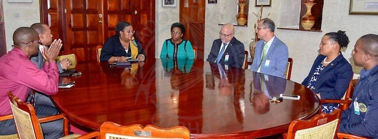 Prime Minister Mia Mottley (third from left) and the BERT Monitoring Committee during this morning's signing.