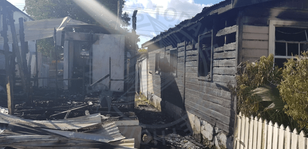 One house, apartments and a salon were destroyed by fire in King William Street, The City, Sunday night, while the home of an elderly couple was extensively damaged.