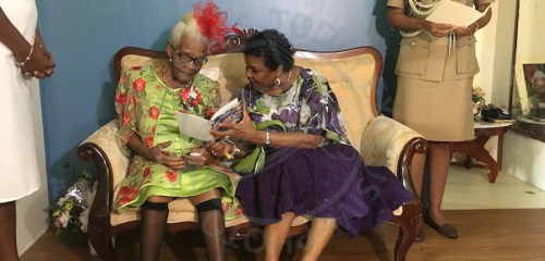 Centenarian Lilian Batson receives a birthday card from Governor General Dame Sandra Mason.