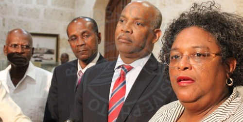 Prime Minister Mia Mottley (right) flanked by (from left) former Commissioner of Police Darwin Dottin, Commissioner of Police Tyrone Griffith and Attorney General Dale Marshall during tonight's press conference.