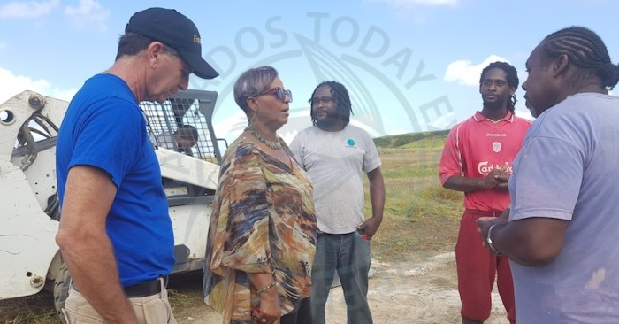 Member of Parliament for St Thomas Cynthia Forde (second from left) and businessman David Spieler (left), with some of the men who assisted in removing a pile of marl that blocked the road at Vaucluse, St Thomas.