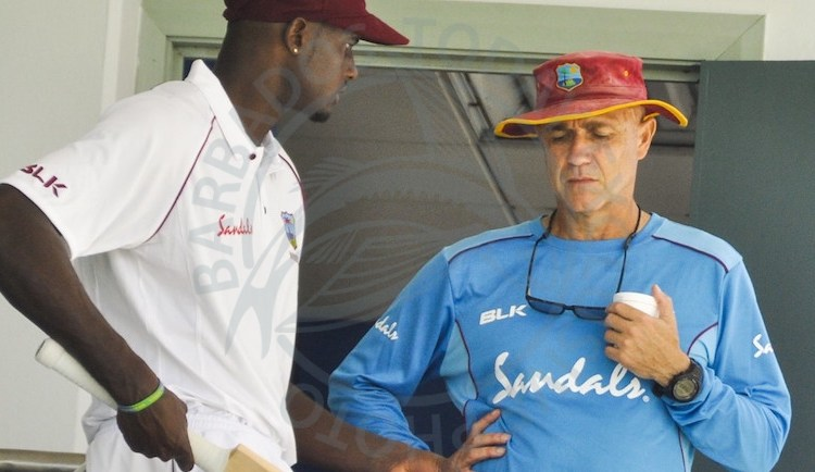 Captain Jason Holder discussing strategy with coach Richard Pybus ahead of tomorrow's first Test.