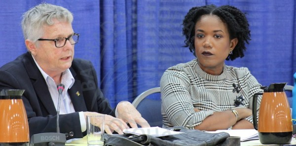 Minister in the Ministry of Economic Affairs and Investment Marsha Caddle (right) looks on as Attorney-at-law Christine Toppin-Allahar makes a point. The legal consultant said it was only fair that both those accepting bribes and those offering be penalized.
