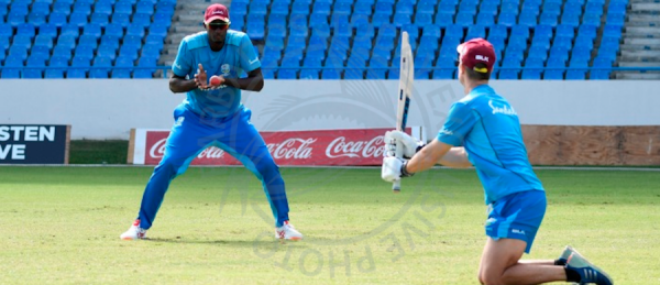 Jason Holder (left) practising his slip catching ahead of tomorrow's Test.