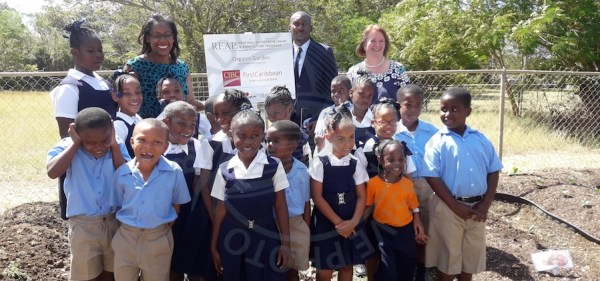 Students of the Roland Edwards school in the garden with Project Director of the regional Entrepreneurship and agriculture program, Marsha-Ann Clarke (left), Coordinator of the UNDP Small Grants Program, David Bynoe and CEO of CIBC Colette Delaney.
