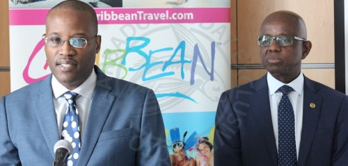 Secretary General of the Caribbean Tourism Organisation Hugh Riley (right) and Acting Director of Research and IT Ryan Skeete.