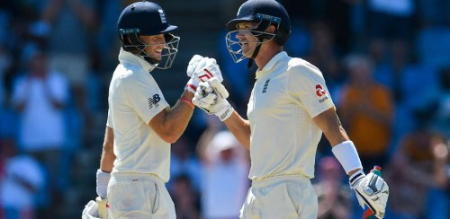 Captain Joe Root (left) and Joe Denly celebrating the latter's first Test fifty. Root went on to make a century.