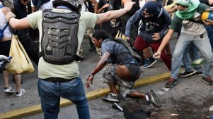 Orlando Figuera is set on fire by a group of opposition protesters in Altamira on May 20. (AFP)