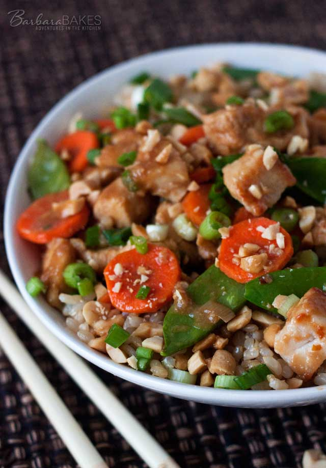 A quick and easy Kung Pao chicken loaded with fresh veggies in a spicy sauce sprinkled with green onions and chopped peanuts.