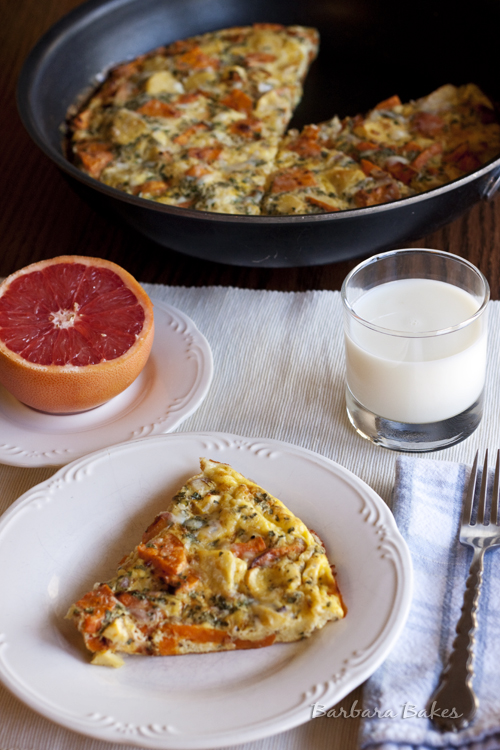 Roasted-Vegetable-Frittata on a white plate with half a grapefruit and a glass of milk