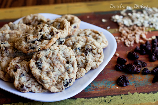 A Cherry Chocolate Chip Oatmeal Toffee Cookie loaded with oatmeal, tart dried cherries, rich chocolate chips, and crunchy toffee bits.