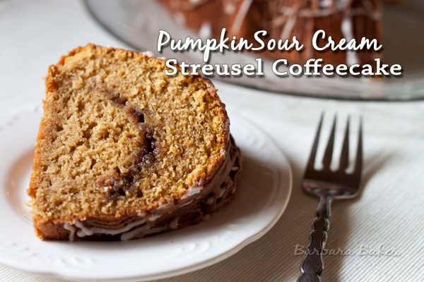 a slice of Pumpkin Sour Cream Coffee Cake on a white plate with a fork