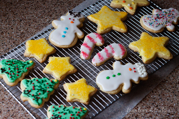 Christmas Sugar Cookies decorated and resting on a cooling rack