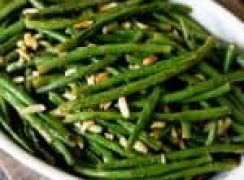 Roasted Green Beans with Almonds served in a large white bowl