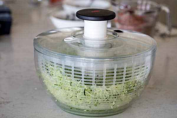 One trick I like to use when I'm making zucchini bread is to spin the grated zucchini in a salad spinner. It removes the excess water from the zucchini so you get consistency results every time.