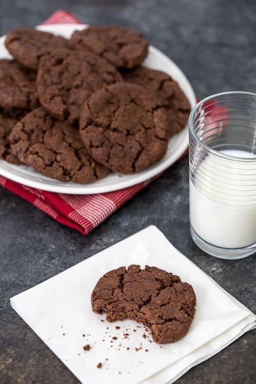 Dorie Greenspan\'s World Peace Cookies on a plate with a glass of mile and one cookie on a napkin