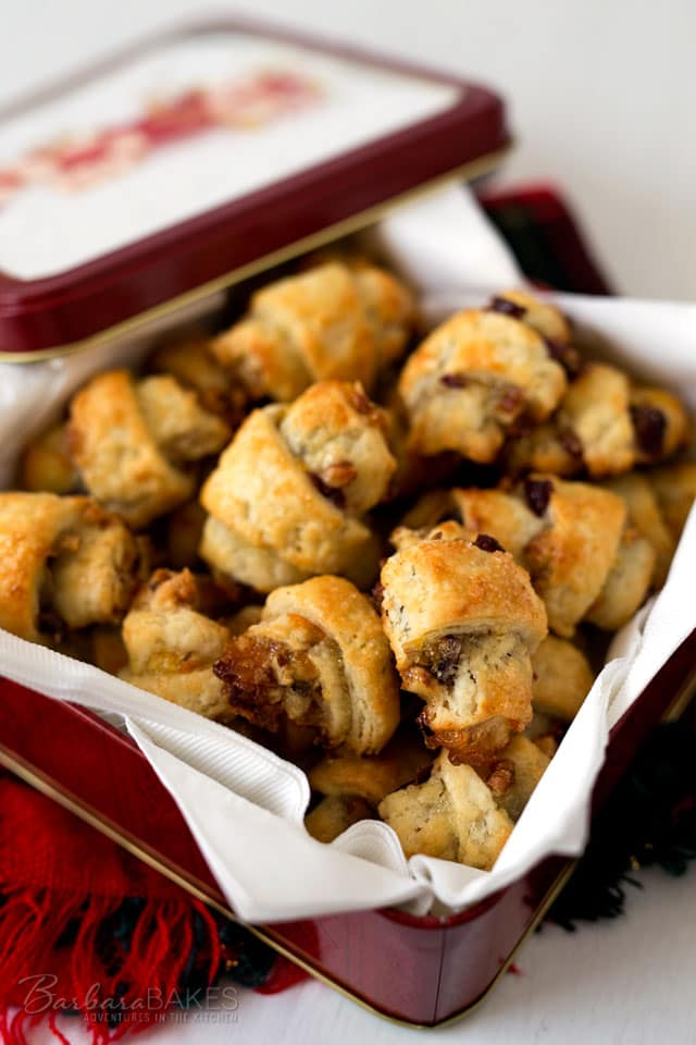 This easy-to-make Orange Cranberry Rugelach is a crisp, flaky pastry spread with orange marmalade, tart dried cranberries and chopped toasted pecans, then rolled up in a pretty crescent shape.
