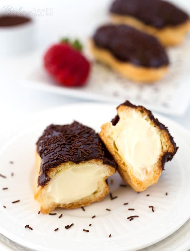Traditional Chocolate Eclair frosted with a fudgy chocolate ice and decorated with chocolate sprinkles.