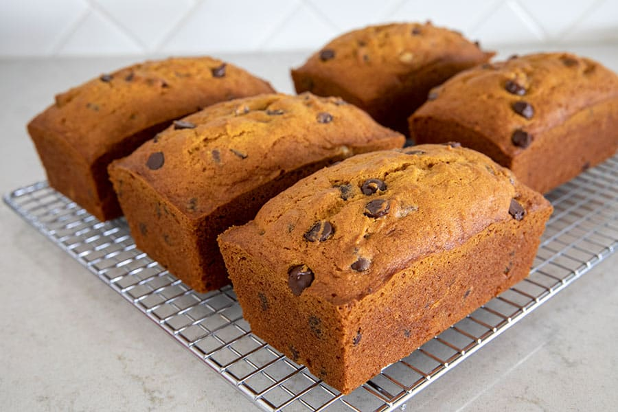 5 loaves of Pumpkin Chocolate Chip Bread on a cooling rack