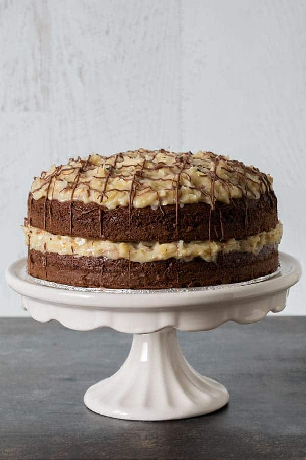 Close up of the Easy German Chocolate Cake, baked with two layers of chocolate and filled and topped with an delicious Coconut-Almond Frosting
