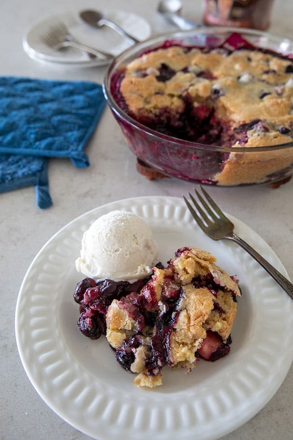This Apple Blueberry Brown Butter Bliss is a cross between a fruit cobbler and a cake. The sugar sprinkled on top before baking gives it a nice crunch and is the perfect addition to this old fashioned dessert.
