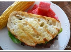 Featured Image for post Caesar Salad Flank Steak Burgers with Garlic Crostini