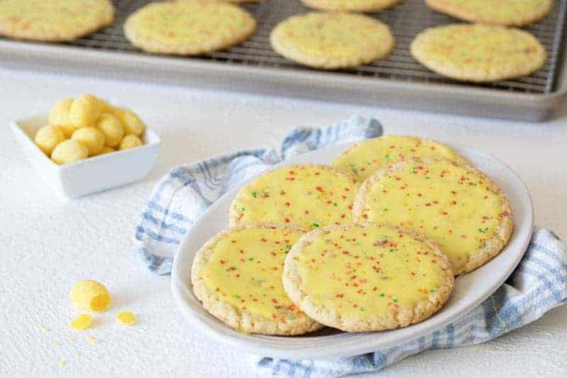 These Over The Top Lemon Drop Candy Cookies are a bakery style cookie that's a thin, tender, chewy, with a bright lemon flavor.
