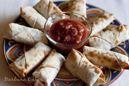 Baked Southwestern Egg Rolls – chicken, black beans, corn, cheese, green chilies, and spices wrapped in a thin egg roll wrapper and baked until they're crispy.