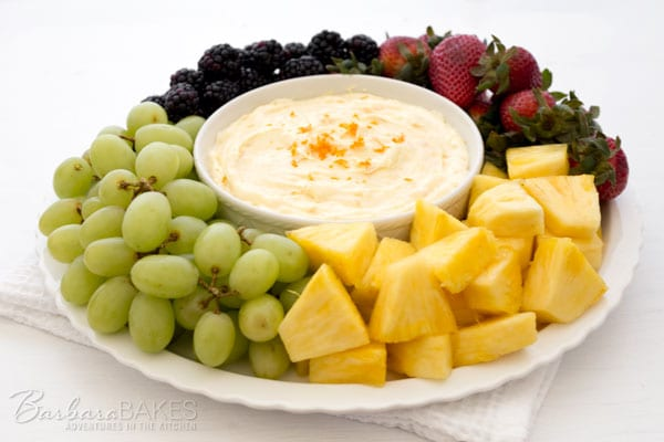 Creamy-Orange-Fruit-Dipwith a plate of fruit including grapes, pineapple, strawberries and blackberries