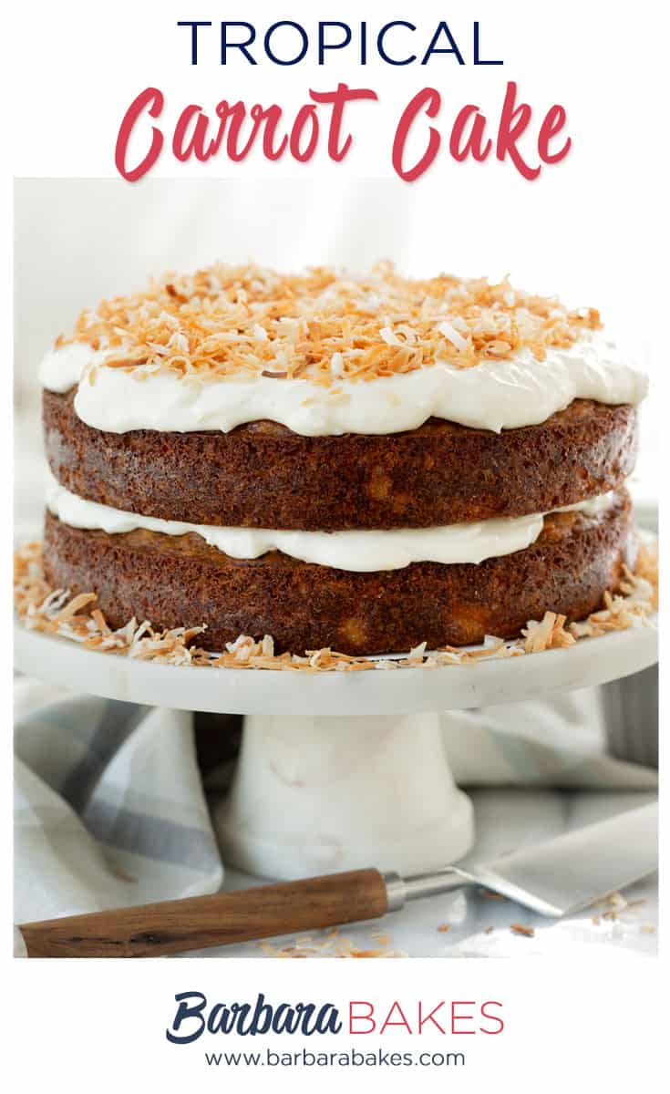 Tropical Carrot Cake with Coconut Cream Cheese Frosting on a marble cake stand