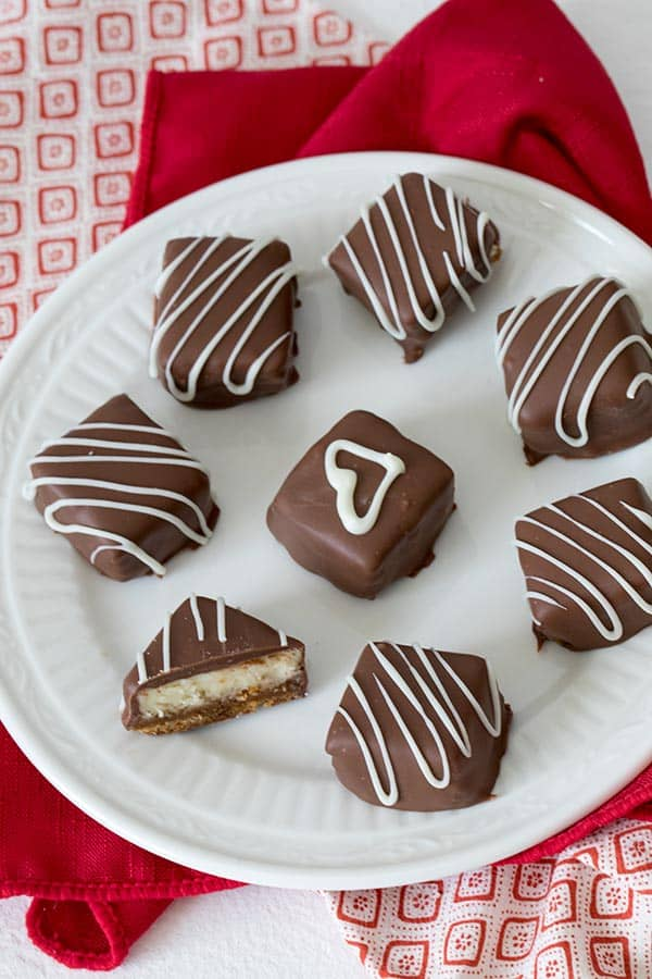 Cheesecake with a layer of caramel over a graham cracker crust wrapped in luscious chocolate. TheseChocolate Caramel Cheesecake Bites are a perfect, irresistible Valentine\'s treat for your sweetheart.