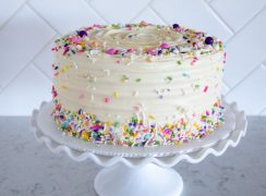 Triple Layer Chocolate Cheesecake with Cream Cheese Frosting and colorful sprinkles