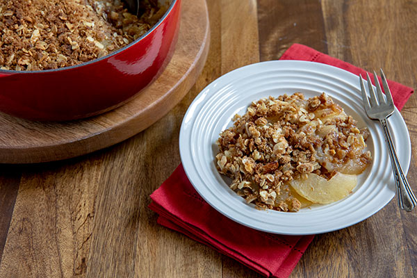 perfect apple crisp plated in a bowl and ready to be served