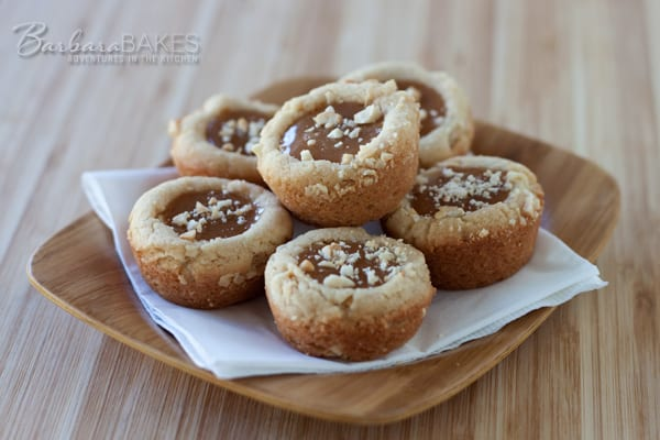 Caramel Cashew Cookie Cups - Cookie cups made with rich cashew butter, crunchy chopped cashews and filled with a soft, gooey caramel