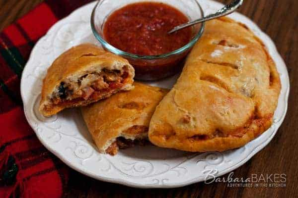 homemade meat lovers calzones on a plate