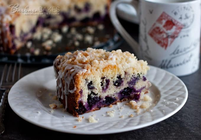 a plated slice of lemon blueberry coffee cake