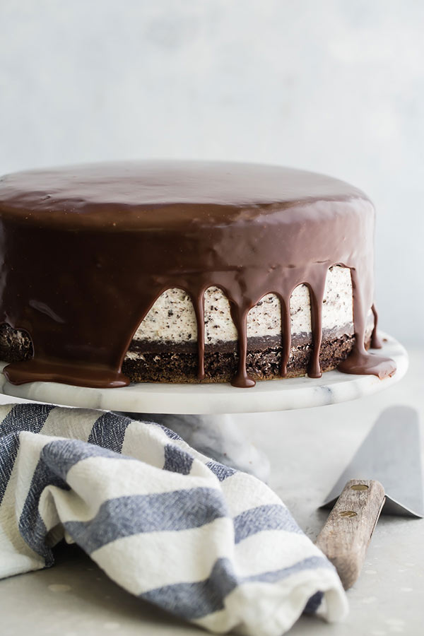 Chocolate Cake with an Oreo Cheesecake Filling on a white cake stand