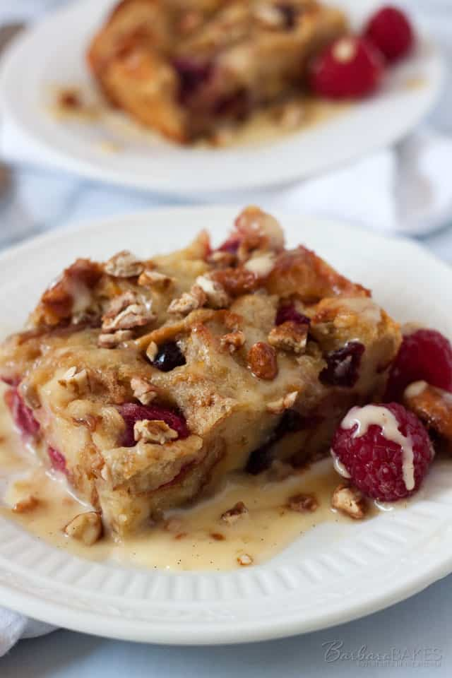 Luscious bread pudding made with a mix of croissants, thick sliced white bread, raspberries and dried cranberries, baked until it\'s golden brown and served warm with a smooth, rich, vanilla cream sauce.