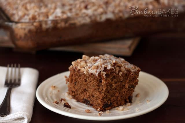 Applesauce Spice Coffee Cake with a crumbly pecan topping and a sweet drizzle on top.
