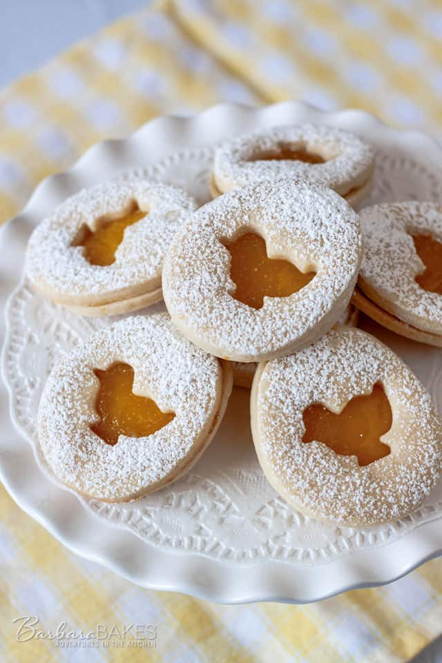 Lemon Easter Shortbread Sandwich Cookies with a Tart Lemon Curd Filling.