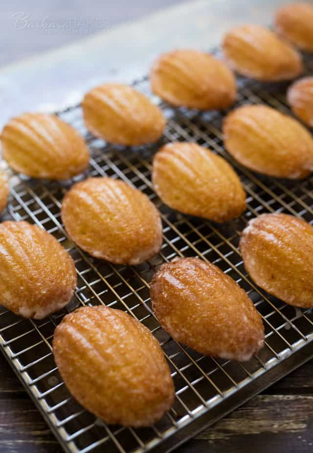 Easy to make Lemon Glazed Madeleines on a cooling rack