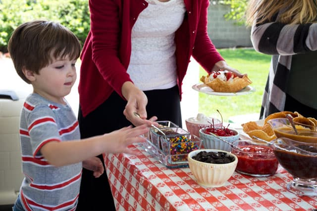 Enjoy a Summer Ice Cream Sundae Social with homemade ice cream waffle bowls and cones.