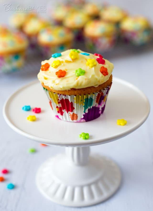 Orange Creamsicle Cupcakes with a fun orange soda cupcake frosted with a luscious, sweet orange cream cheese icing.