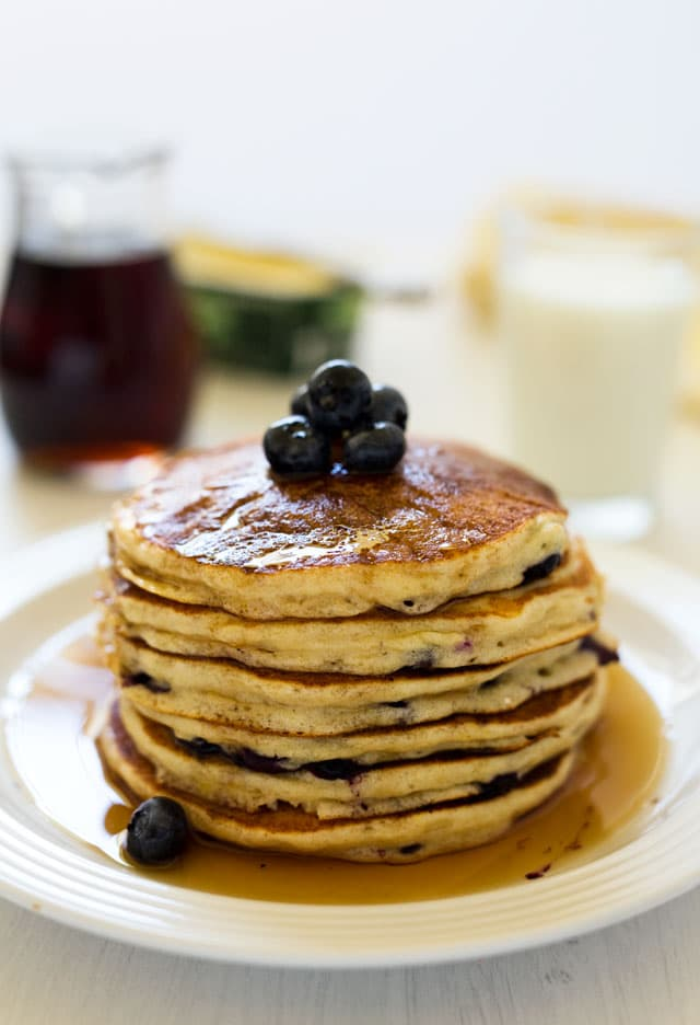 These light and fluffy whole wheat lemon ricotta blueberry pancakes are a must try.