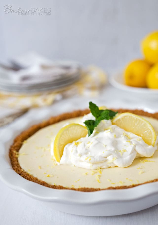 A Creamy Lemon Yogurt Pie in a crisp graham cracker crust. The easy-to-make lemon filling gets it\'s creamy texture and a little extra tang from the addition of Greek yogurt.
