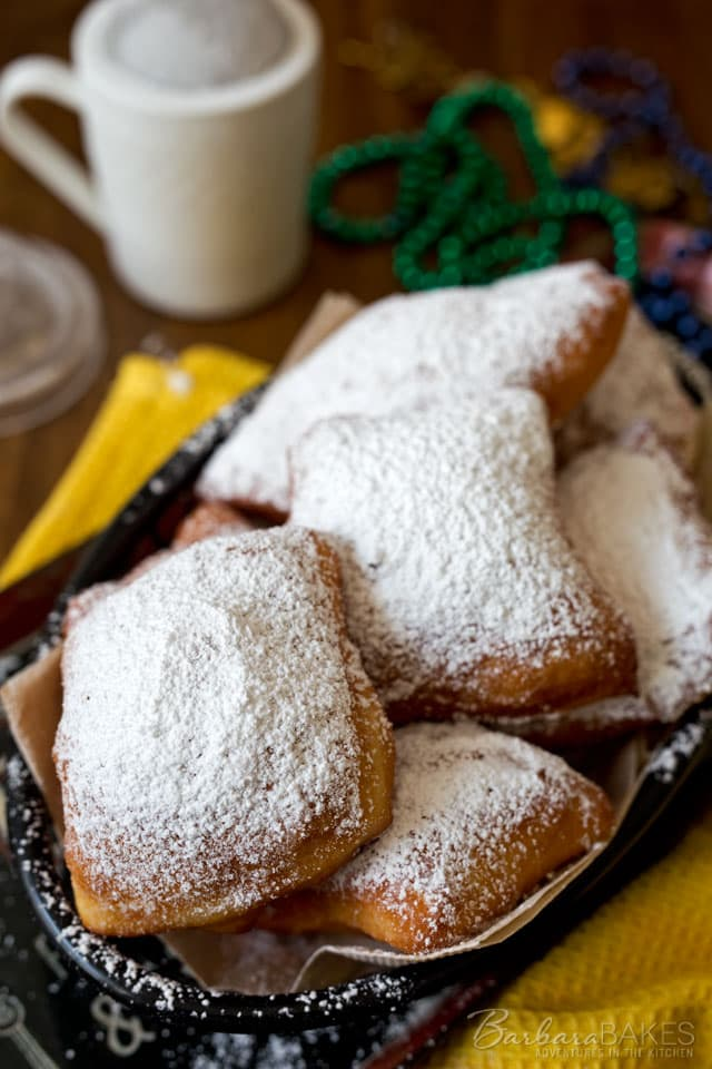 Light and airy easy beignets served piping hot dusted with a thick layer of powdered sugar. An irresistible French doughnut that is a New Orleans speciality.