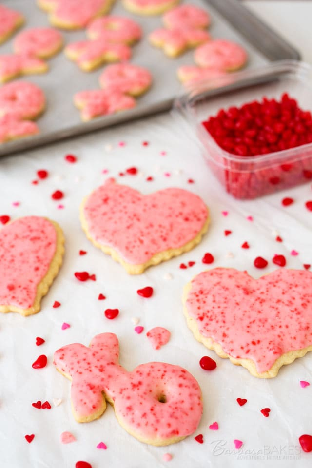 Spice up this year\'s Valentine sugar cookies with cinnamon. These fun Red Hot Sugar Cookies start with a tender sugar cookie base that\'s iced with a cinnamon frosting loaded with crushed Red Hot candies.