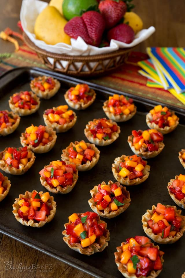 These Strawberry Mango Salsa Cups are sweet, juicy, crunchy and super easy to make. They\'re a great combination of flavors and textures perfect for summer.