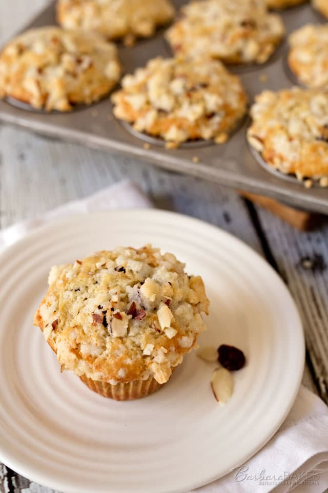 Tender, moist Sourdough Banana Bread Muffins studded with dried cranberries and topped with a crunchy, sweet almond streusel. A fabulous way to start the day.